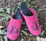 Hot Pink Suede Clogs With A Black Monogram  . . .