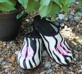 Zebra Fur Clogs With A Hot Pink Diamond  . . .