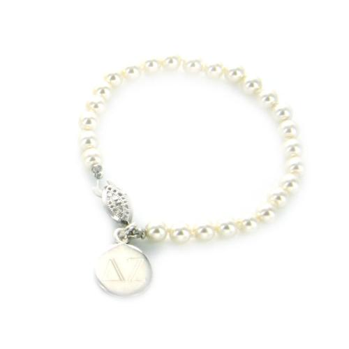 pearl bracelet with monogrammed charm at the pink