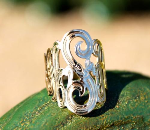 monogrammed ring with hand engraved details crafted in