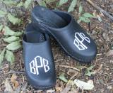 Black Leather Clogs With A White Diamond  . . .
