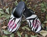 Zebra Fur Clogs With A Garnet Interlocking  . . .