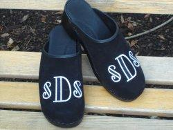 Black suede clog with black and white deco font Black suede clog with black and white deco